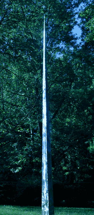 Taller than normal peace pole - three time normal height. It is shaped like a steeple, beginning its slope to a point starting at the ground.
